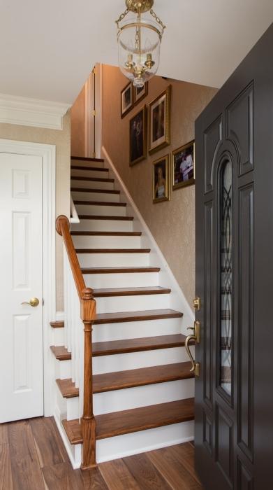 open door stairs white wood warm gallery wall charcoal door