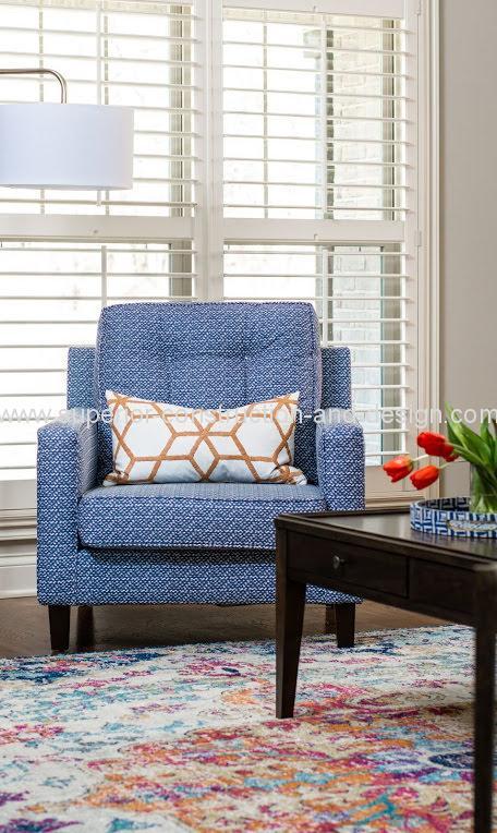 blue upholstered chair orange white pillow living room decor lebanon tn