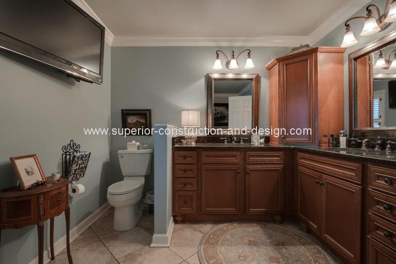 master bathroom before remodel dated tn light tile floors dark wood cabinets