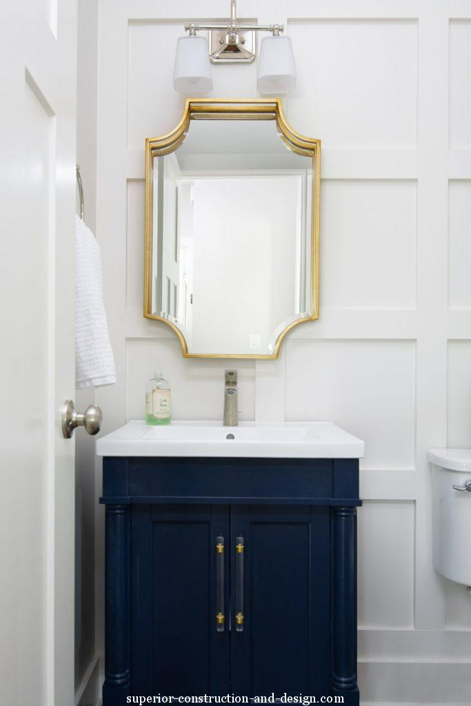 lake home new build superior construction and design gc powder room gold mirror navy vanity