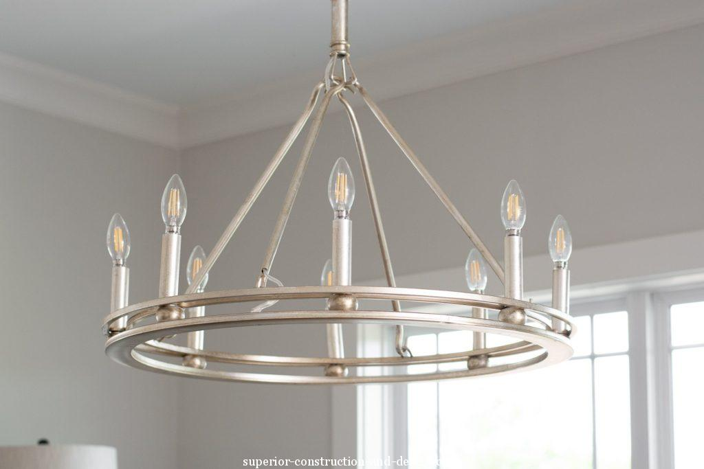modern traditional chandelier with candles crown jewel dining area