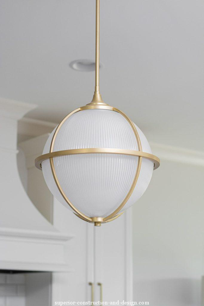 interior design new build lake home tour GC ID modern traditional pendants globe brass detail