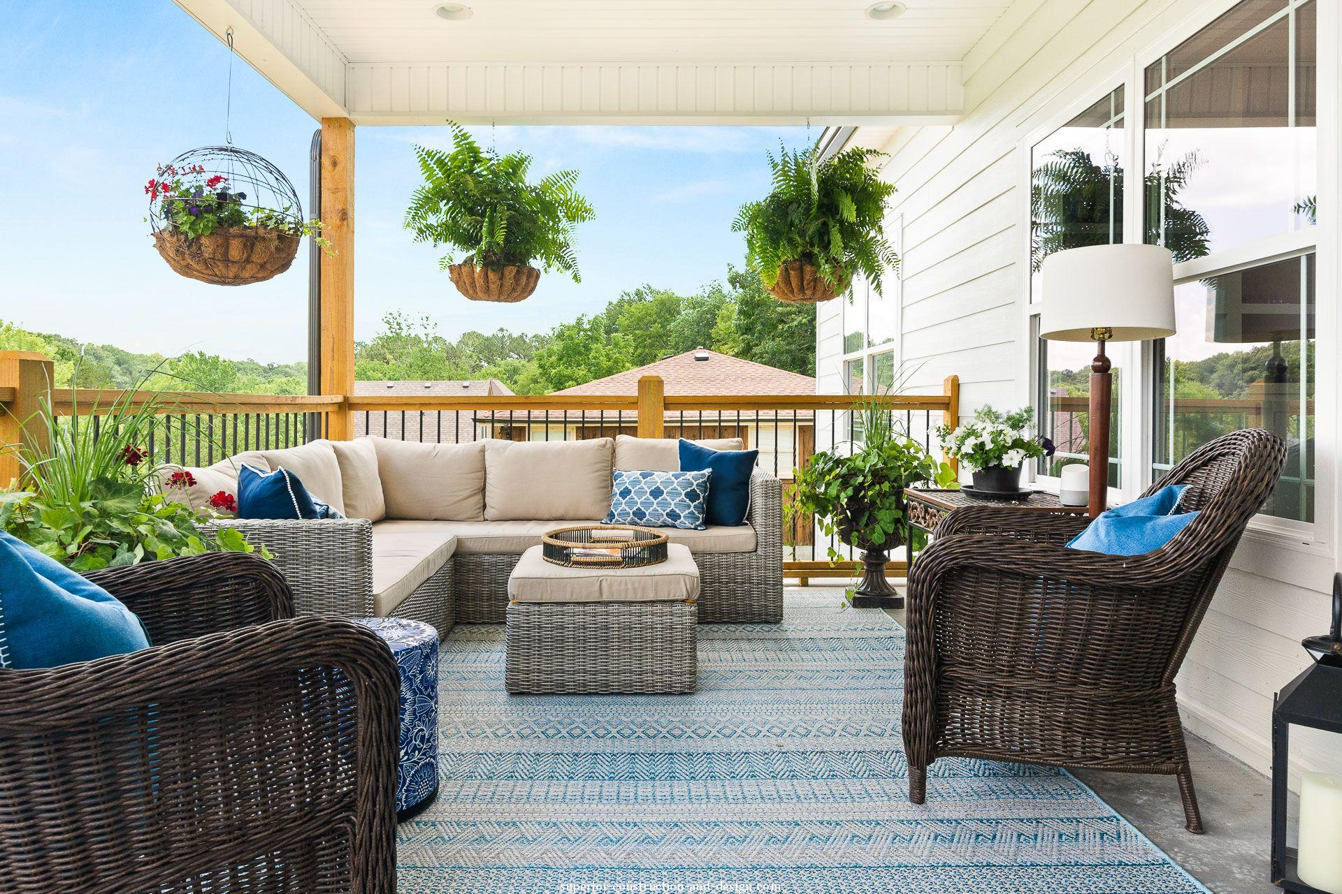 interior design new build lake home tour GC ID covered porch fresh blue outdoor furniture entertaining area