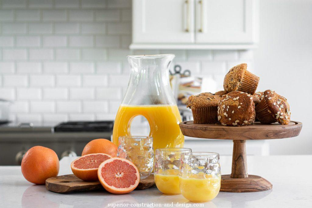 kitchen fruit orange juice vignette colorful pink yellow muffins