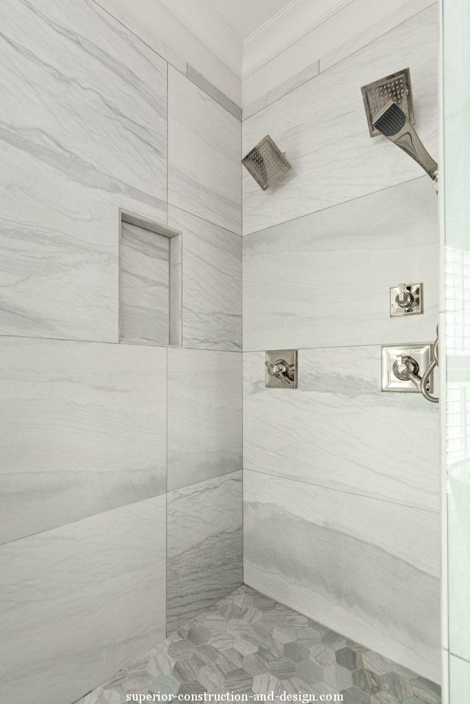 lake home new build superior construction and design gc stone shower custom veining silver hardware