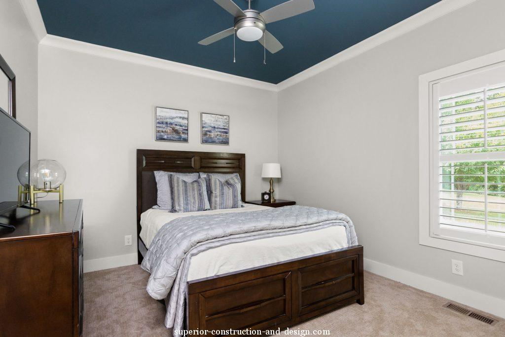 lake home new build superior construction and design gc  guest bedroom