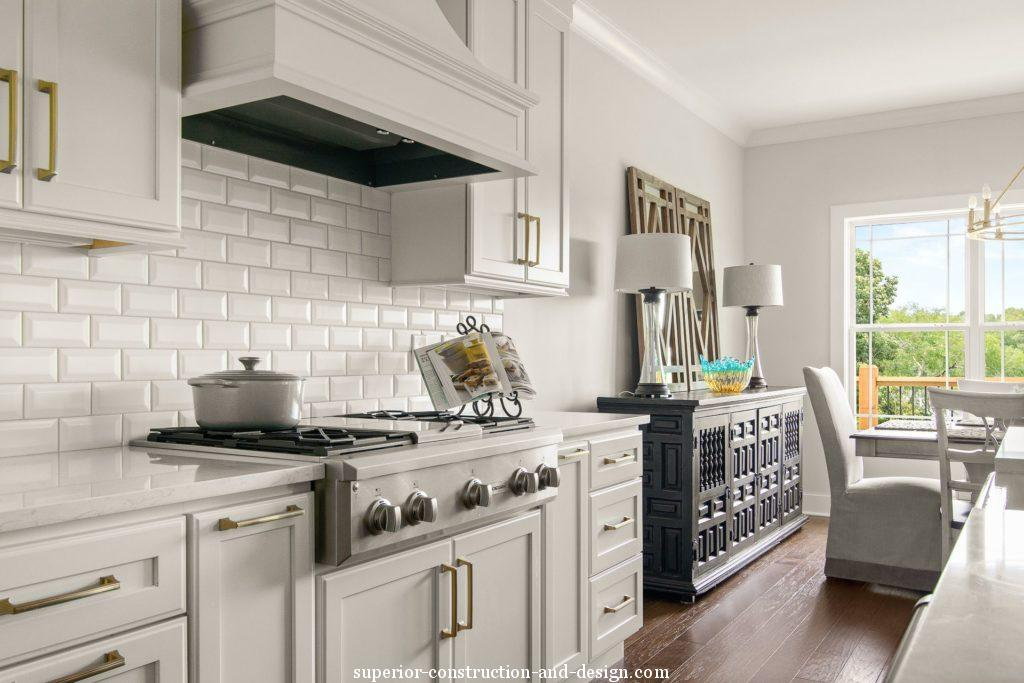 interior design new build lake home tour GC ID kitchen white subway tile monogram appliances elegant timeless