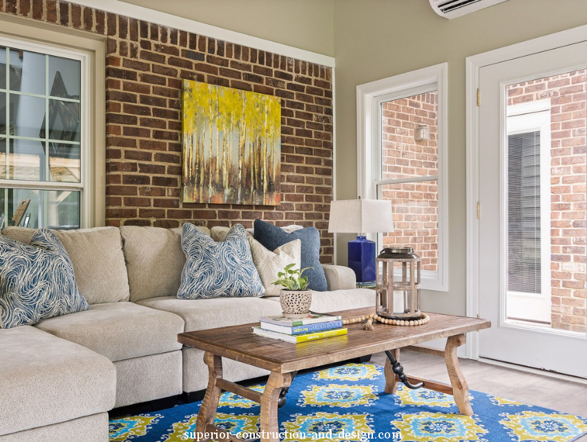 Superior construction and design Lebanon, TN  sunroom with rectangular coffee table exposed brick wall