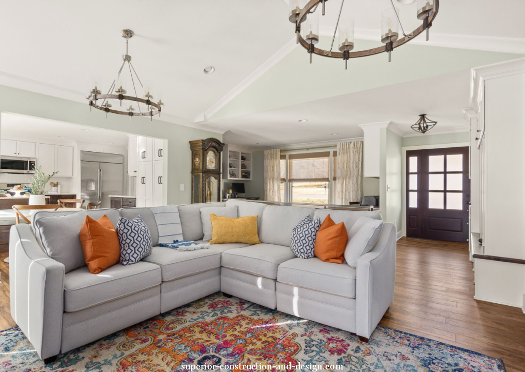 superior-constructin-and-design-lebanon-tn-what-to-look-for-in-quality-sofas-and-chairs-gray-sofa-sectinal-pillows-pops-of-yellow-orange-light-blue-open-concept-living-room