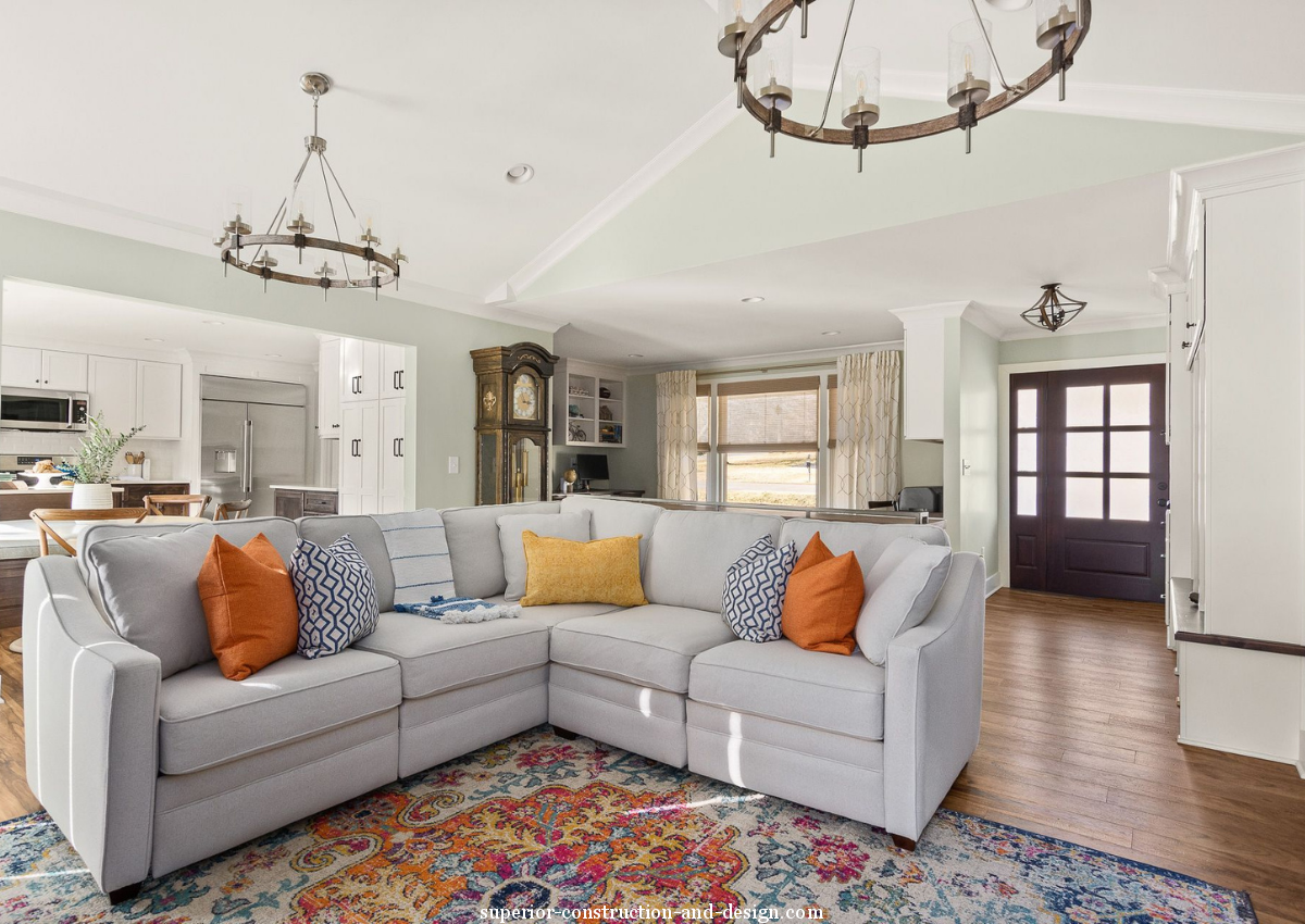 superior-construction-and-design-lebanon-tn-what-to-look-for-in-quality-sofas-and-chairs-gray-sofa-sectinal-pillows-pops-of-yellow-orange-light-blue-open-concept-living-room